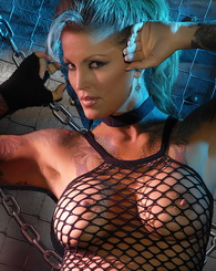 Janine Lindemulder shows off her hot jail house body, while licking up some ice cold milk before bathing in it.